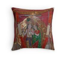 Statue of Lord Krishna and Radha inside a glass case with a cloth cover Throw Pillow