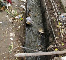 A dirty drain with filth all around it, representing a health risk by ashishagarwal74