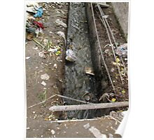 A dirty drain with filth all around it, representing a health risk Poster