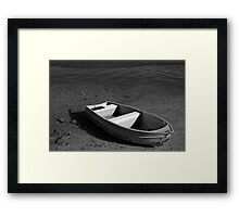 lonely litte boat Framed Print