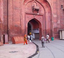 People entering the entrance gate to the red colored Red Fort in New Delhi, India by ashishagarwal74