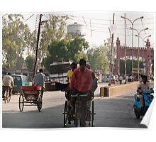 Man plying a manual rickshaw on a small town street in India Poster