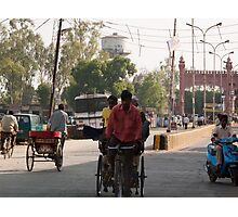 Man plying a manual rickshaw on a small town street in India Photographic Print