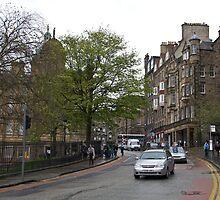 Cars on a road in Edinburgh by ashishagarwal74