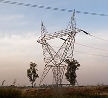 A large steel based electric pylon carrying high tension power lines by ashishagarwal74