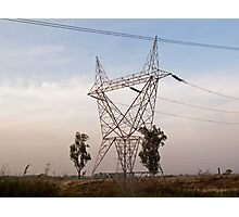 A large steel based electric pylon carrying high tension power lines Photographic Print