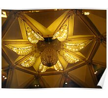 The beautifully lit chandelier on the ceiling of the ISKCON temple in Delhi Poster