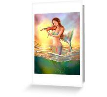 Beautiful  fantasy mermaid plays on violin on sunset Greeting Card