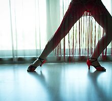 Woman legs in dancing pose by GemaIbarra