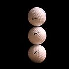 Stacking 3 Golf balls by ClickSnapShot