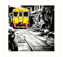 Train coming toward the market with food still on the ground. Art Print