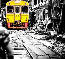 Train coming toward the market with food still on the ground. by hangingpixels