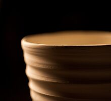 Pottery on wheel close up by Flaxmadeus