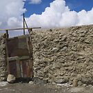Small gate in a stone wall (Karakul) by Marjolein Katsma