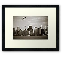 Manhattan over the river Framed Print