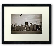 Manhattan over the river Framed Print