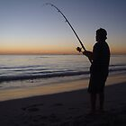Beach fishing at Sunset by BigAndRed