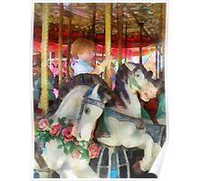 Little Boy on Carousel Poster