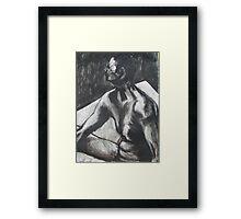 Man sitting on floor Framed Print