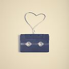 Music retro black cassette and tape heart shaped by Andreka