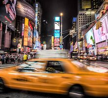 Taxi in times square by paulcowell