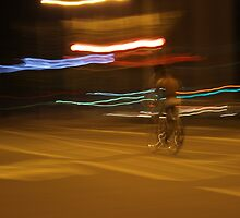Bicyclist in the night by Kirill Molodtsov