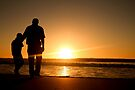 Father and son on the beach... Each new day has its own anticipations... by Qnita