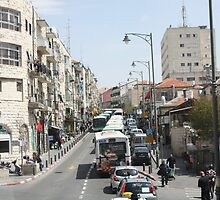 Buses on Jaffa Street, Jerusalem by Carol Singer