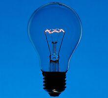 Floating bulb on blue background by mattiaterrando