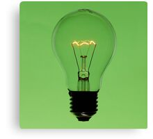Floating bulb on green background Canvas Print