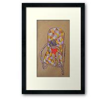 On the armchair Framed Print