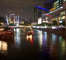 Boat making its way down river at Clarke Quay in Singapore by ashishagarwal74