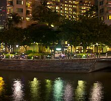 Building to one side of Clarke Quay along with reflection in water by ashishagarwal74