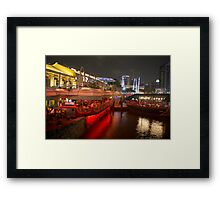 Boats moored on water at Clarke Quay in Singapore  Framed Print