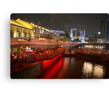 Boats moored on water at Clarke Quay in Singapore  Canvas Print