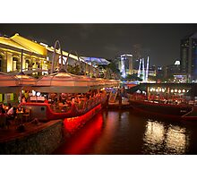 Boats moored on water at Clarke Quay in Singapore  Photographic Print
