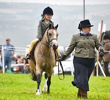 Young Rider Gets A Helping Hand by lynn carter
