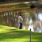 Late afternoon sun & Fisherman, Lachlan River, Forbes. by Rita Blom