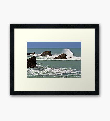Waves crashing against rocks Framed Print
