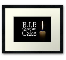candle and rip chocolate cake Framed Print