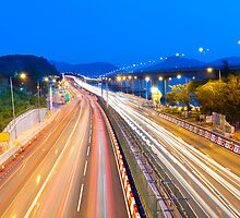 Majestic highway traffic in Hong Kong at night by kawing921