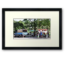Waiting for a ride. Framed Print
