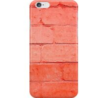 Red background of bricks with a layer of paint closeup iPhone Case/Skin