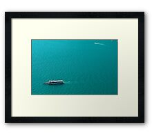 Boat over water Framed Print