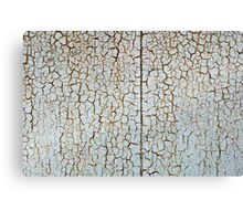 Rusty metal surface is covered with a thick layer of paint Canvas Print