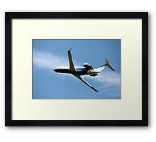 airplane in the blue sky Framed Print