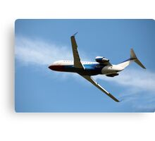 airplane in the blue sky Canvas Print