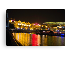 Shimmering lights and reflection in river water at Clarke Quay in Singapore Canvas Print