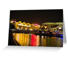 Shimmering lights and reflection in river water at Clarke Quay in Singapore Greeting Card