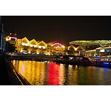 Shimmering lights and reflection in river water at Clarke Quay in Singapore Photographic Print